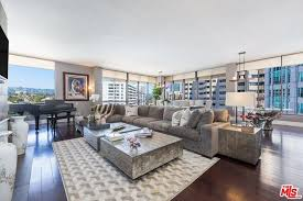 adding to the elegance of this stylish are the voluminous high ceilings recessed lighting hardwood floors granite in the kitchen and marble