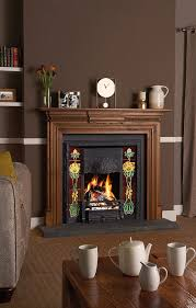stovax art nouveau tiled fireplace in matt black with optional cast iron back and rhododendron fireplace tile sets shown with sworth wooden mantel in