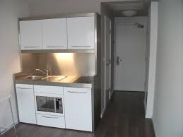 mesmerizing white acrylic mini kitchen cabinet with silver frame panels as well as single undermount sink also grey fake wood floors as decorate in guest