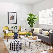 living room area rug yellow chairs ottoman