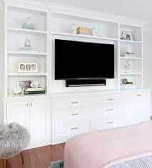 shallow tv builtins bedroom wall