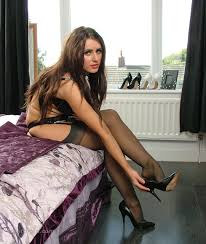 Hot brunette Carla shows off her fit body in sexy black lingerie.