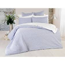 an elegantly simple design featuring horizontal lines set on a white base this bedding set has huge potential