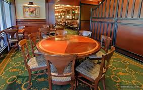 this round table is set for seven guests in one of the turf club s overlook type