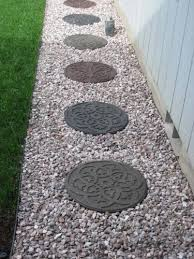 envirotile reversible scroll 18 in x 18 in round rubber earth