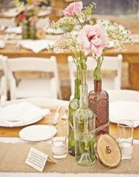 Wine Bottle Wedding Decoration Ideas If you're throwing a winethemed wedding here's a cheap center 2