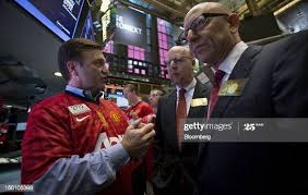 "A trader speaks with Avram ""Avi"" Glazer, center, and Joel Glazer,... News  Photo - Getty Images"