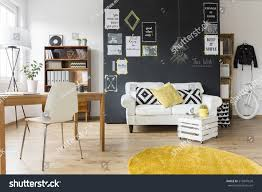 creative living furniture. Creative Living Room With Chalkboard Wall, Wooden Desk And Vintage Furniture