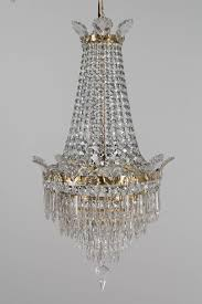 a french empire style three light crystal chandelier with brass frame a beautiful waterfall