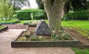 engraved garden stones. Celtic Triskele Pattern Engraved On Small Quarried Granite Standing Stone, Private Garden, Garden Stones