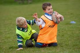 ollie is a keen rugby player and is enjoying sharing his skills with the younger children