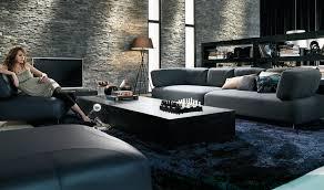 modern textured stone wall living room with dark blue rug blue dark trendy living room