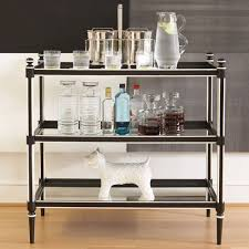 A modern bar cart is a great permanent fixture for any den or entertaining  space. Use sleek black and white along side accent pieces, like this  adorable dog ...