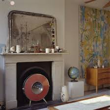 large mirror above marble mantlepiece