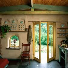 a strength of earthen materials is their performance flexibility the wall section above the door