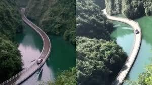 Amazing! Vehicle passes floating <b>bridge</b> with rising <b>waves</b> on river ...