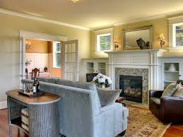 bookshelves next to fireplace living room traditional with tile fireplace crown molding recessed panel