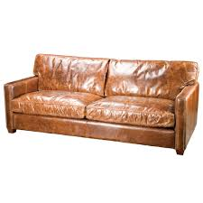 comfortable brown distressed leather couches in a rustic style