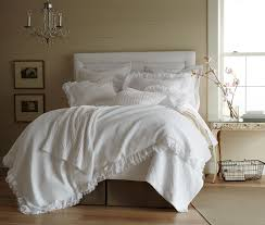 white shabby chic bedding in a neutral