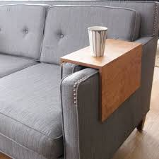 couch arm wrap a space saving alternative to coffee tables