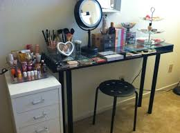 interesting glass top makeup vanity table featuring steel stool with holed seat and underglass storage compartment