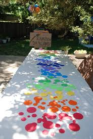 rainbow table cute inexpensive and simple idea to brighten up any table at a rainbow birthday party wizard of oz party and more