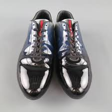 prada sneaker dress shoes come in a high shine patent leather with a black to blue