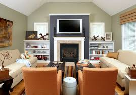 black accent wall family room traditional with leather ottoman family room