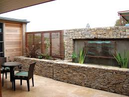 Decorations:Unique Modern House With Dark Brown Brick Outdoor Accent Wall  And Front Yard Garden