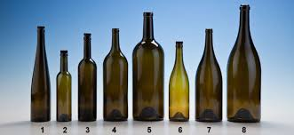 glass corked antique green wine bottles with bartops and some without corks