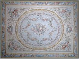 avignon aubusson rug 9407c has beige field with al instruments and a large cream oval medallion