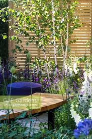 Garden Designers London Delectable GAP Gardens Seating Area With Wooden Bench Surrounded By Salvia