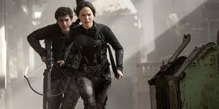 liam hemsworth and jennifer lawrence in hunger games mockingjay