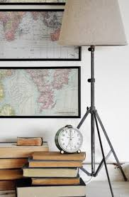 DIY Tripod Lamp ~ This tripod lamp is right on trend! It's made from an old  music stand and a lamp kit!