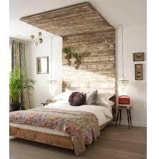 wood headboard in a eclectic bedroom