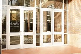 office front doors. Business: Empty Office Building, School. Front Doors Are Closed. Royalty-free R