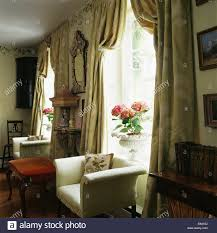 Silk Curtains For Living Room Cream Armchair In Front Of Window With Heavy Silk Curtains In