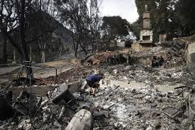 roger kelton searches through the remains of his mother in law s home leveled by
