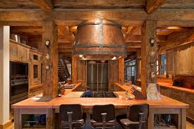 custom wood kitchen with large range hood and wood countertops with solid wood island
