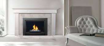 features wooden cabinet fluted pilasters and timeless craftsmanship details complete the classic demeanor of traditional style this fireplace