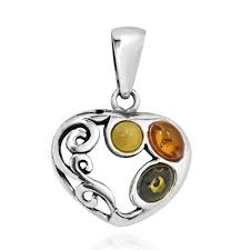 this beautiful pendant features a romantic heart design that is accented with elegant swirls and shimmering amber gemstones