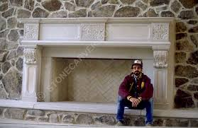stone sculptor and carver walter arnold with large stone fireplace in private collection