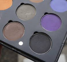 i love the design of the palette it s a sleek black book like palette with magnetic closures it has a small mirror and removable pans