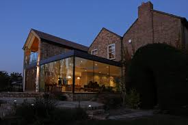 Modern Glass Addition to otherwise Traditional Home