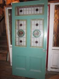 set of 11 doors panels inset with stained glass