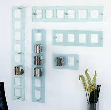 modern wall mounted cd shelf in glass
