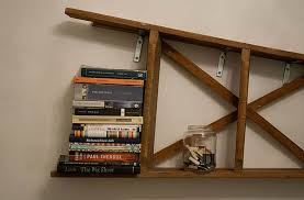 View in gallery Vintage ladder mounted horizontally on the wall