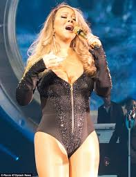Mariah Carey confidently displays her curves in a barely-there ... via Relatably.com