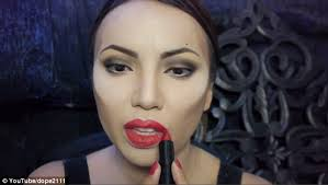 promise colours her lips in before adding a mac lipstick on top the make