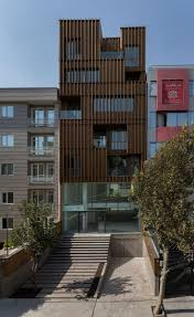 completes Tehran office block with louvred wooden facades (Dezeen
